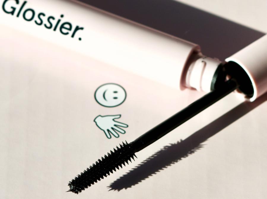 glossier lash stick mascara wand pink background