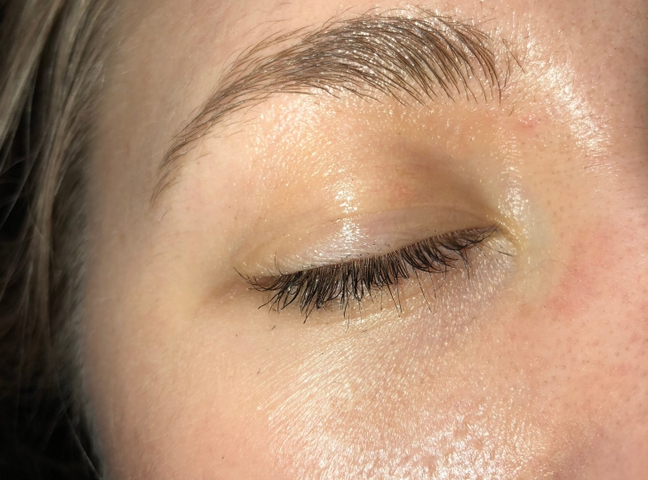 closed eye closeup showing Glossier lash slick after a full workday