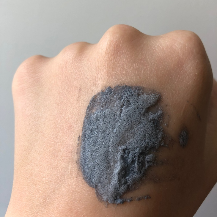 tiam sebum drying black bubble pack on hand after two minutes
